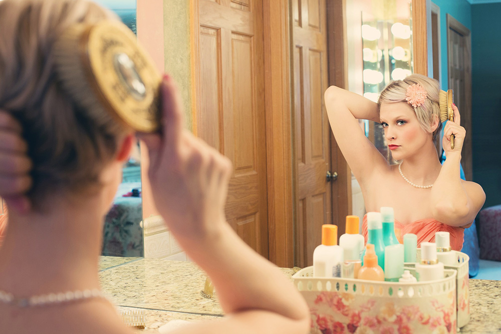 Mirror reflection woman image