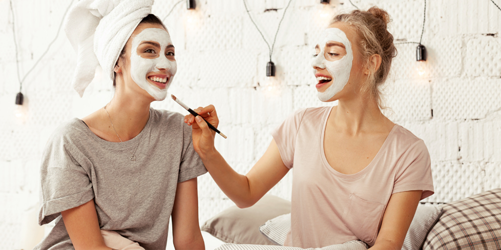 Girls applying face masks image