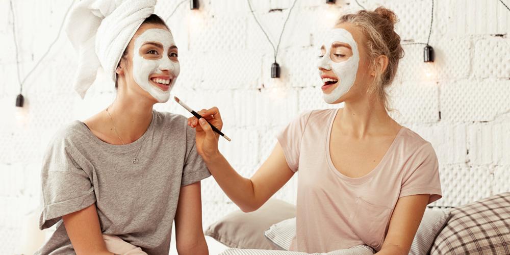 Girls applying face masks image
