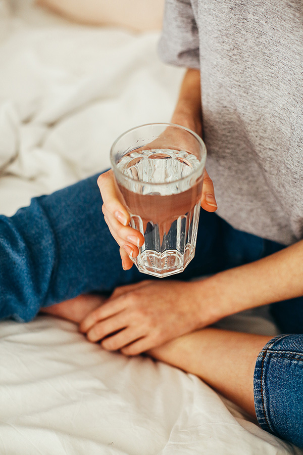 Person holding a glass of water image