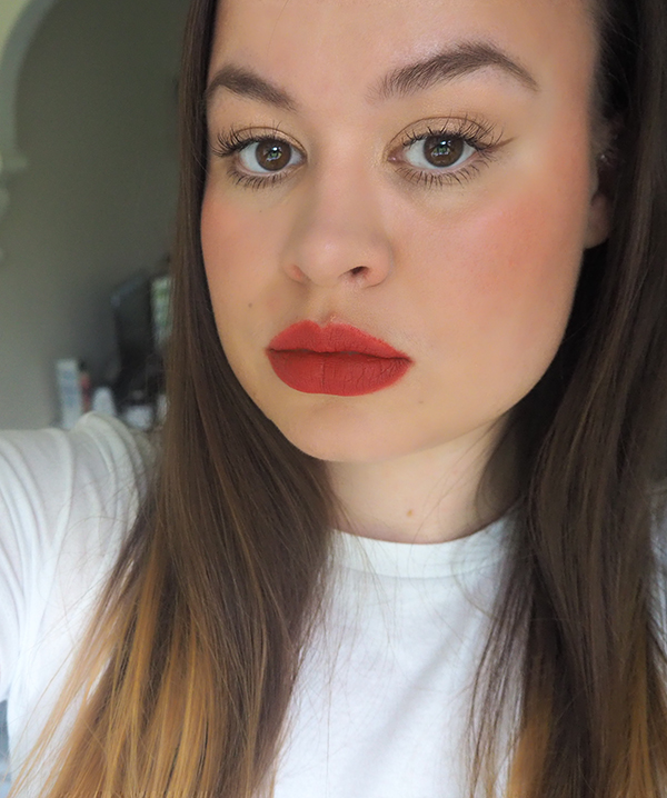 Bold red lip and champagne eyeshadow makeup look image